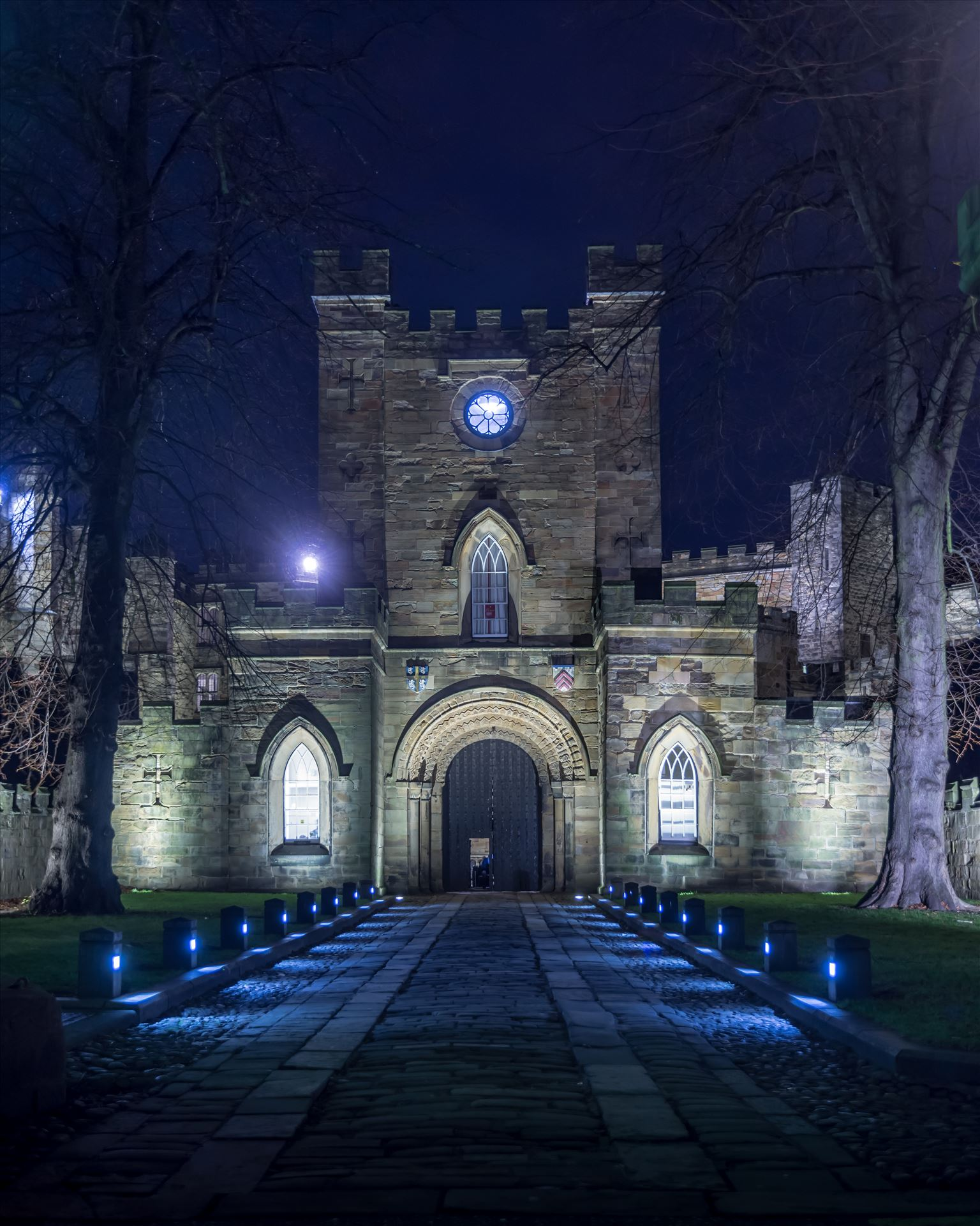 An arch leading to Durham Castle -  by philreay