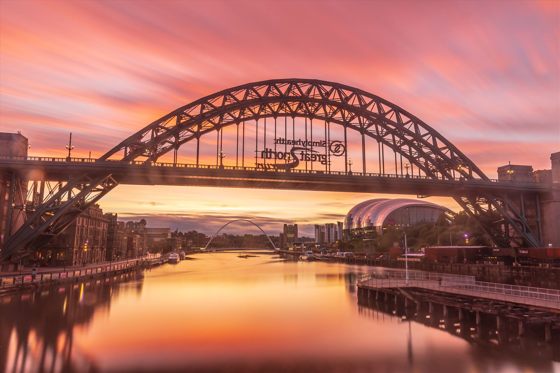 Sunrise on the Tyne bridge, Newcastle - The exposure time on this one was 195 seconds to create the streaking effect in the clouds. by philreay
