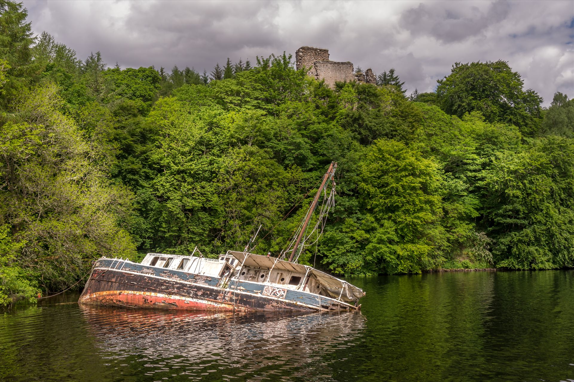 Invergarry Castle & the Eala Bhan - The Eala Bhan shipwreck overlooked by Invergarry Castle on Loch Oich, part of the Caladonian Canal. by philreay