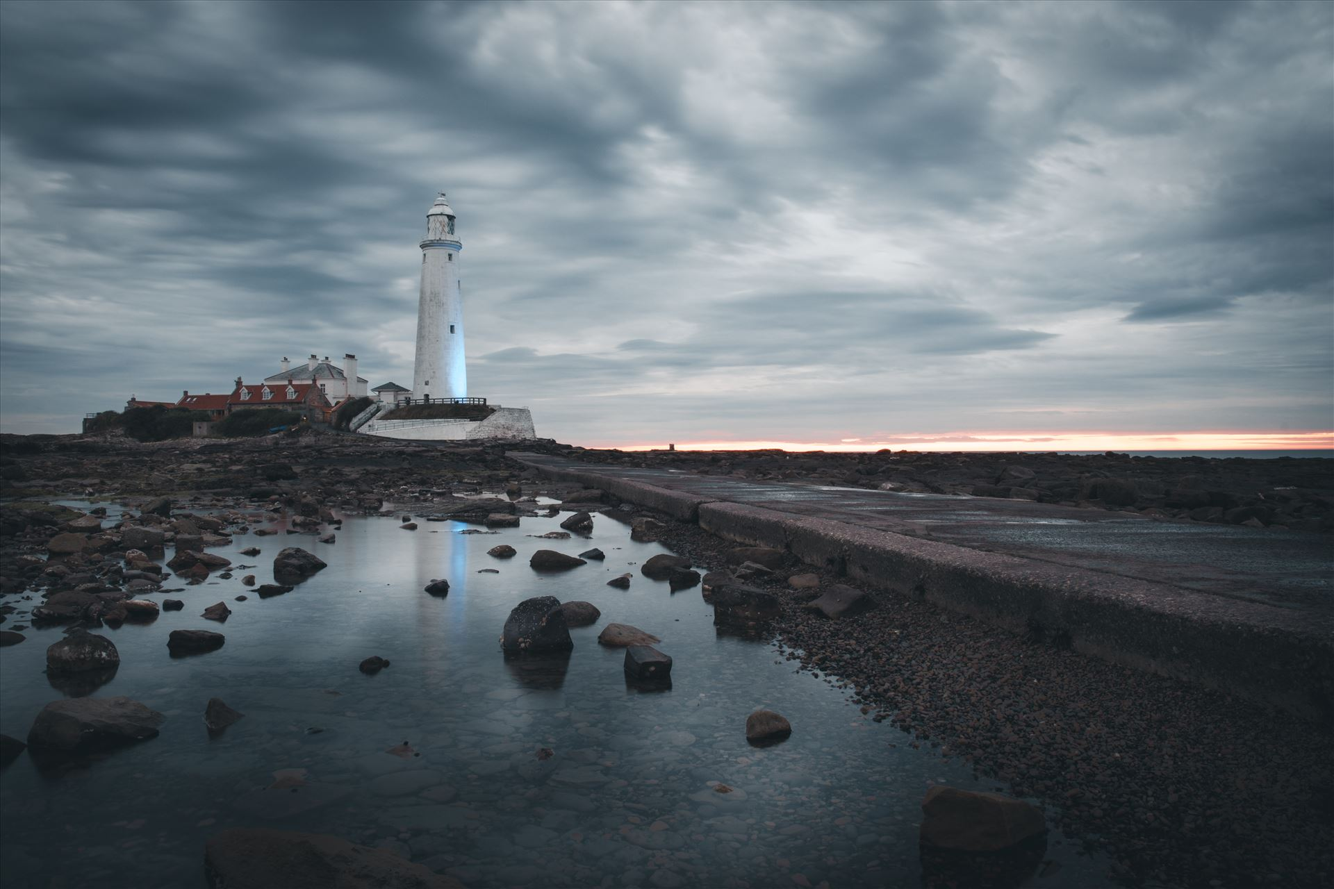 St Mary`s Island & lighthouse - St Mary`s lighthouse stands on a small rocky tidal island which is linked to the mainland by a short concrete causeway and is submerged at high tide. The lighthouse was built in 1898 & was decommissioned in 1984, 2 years after becoming automatic. by philreay