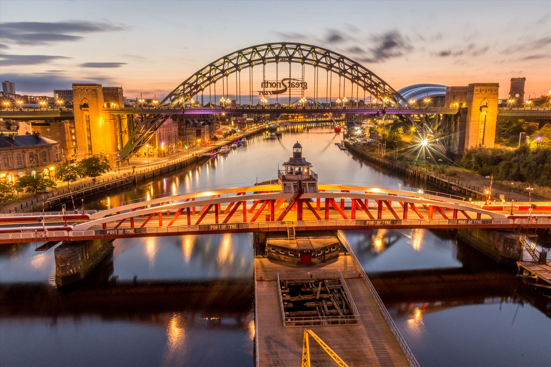 The River Tyne - In the foreground is the Swing bridge, at the top is the world famous Tyne bridge & under that is the Millennium bridge. by philreay