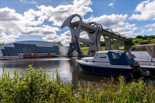 The Falkirk Wheel - The Falkirk Wheel is a rotating boat lift in Scotland, connecting the Forth and Clyde Canal with the Union Canal. It opened in 2002, reconnecting the two canals for the first time since the 1930s as part of the Millennium Link project.