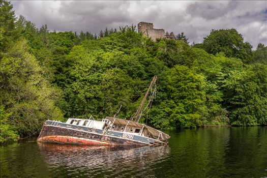 Invergarry Castle & the Eala Bhan - The Eala Bhan shipwreck overlooked by Invergarry Castle on Loch Oich, part of the Caladonian Canal.