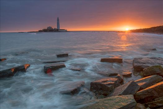 St Mary`s sunrise - St Mary`s lighthouse stands on a small rocky tidal island is linked to the mainland by a short concrete causeway which is submerged at high tide. The lighthouse was built in 1898 & was decommissioned in 1984, 2 years after becoming automatic.