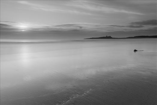 Sunrise at Embleton Bay, Northumberland. (also in colour) - Embleton Bay is a bay on the North Sea, located to the east of the village of Embleton, Northumberland, England. It lies just to the south of Newton-by-the-Sea and north of Craster