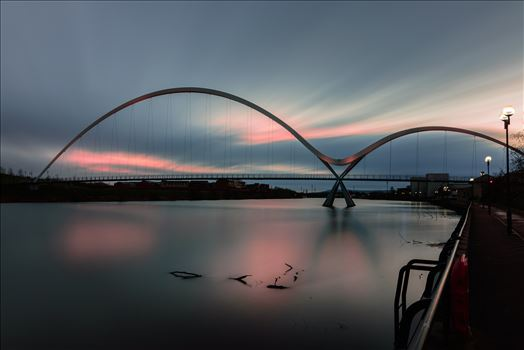 The Infinity Bridge 13 - The Infinity Bridge is a public pedestrian and cycle footbridge across the River Tees that was officially opened on 14 May 2009 at a cost of £15 million.