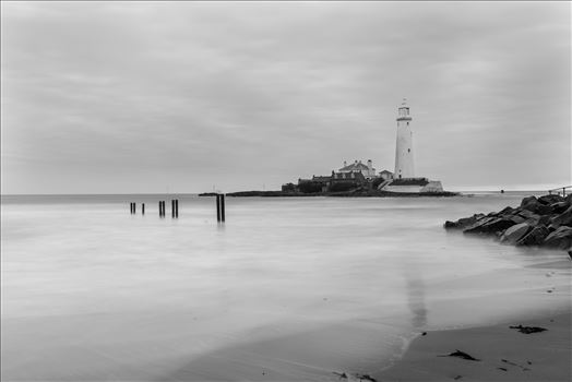 St Mary`s lighthouse, Whitley Bay (B&W) - St Mary`s lighthouse stands on a small rocky tidal island is linked to the mainland by a short concrete causeway which is submerged at high tide. The lighthouse was built in 1898 & was decommissioned in 1984, 2 years after becoming automatic.